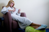 Blond model in bathrobe and slippers poster