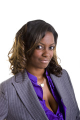A young black businesswoman in a grey suit and purple blouse