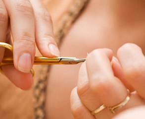Woman doing her manicure - closeup