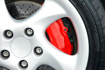 A close up shot of a sports car wheel and brakes