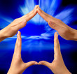 Made from hands conceptual symbol home on bright blue background