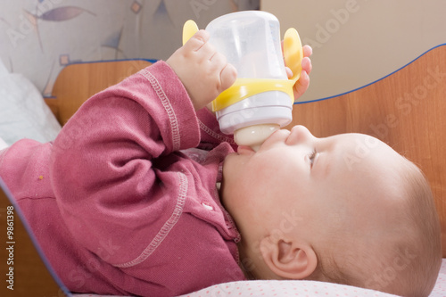 Baby drink milk from bottle Poster