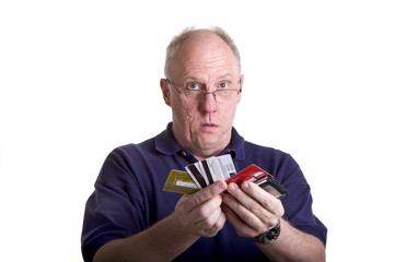 A bald older man handing out all of his credit cards
