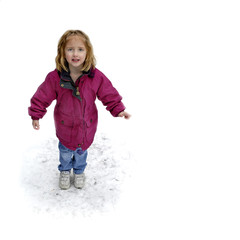 One little girl playing in the snow on a winter day