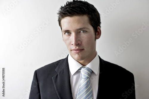 young business man looking cool in a sharp suit