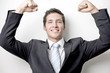 happy business man holding up is arms in joy