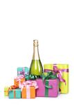 Gifts and champagne bottle on white background. Shallow DOF