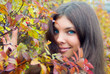 Close-up of woman eyes and autumn leaves