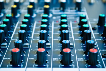 knobs of an audio mixing board