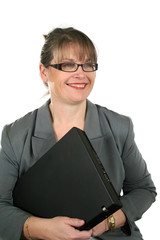 Smiling mature businesswoman with a laptop.
