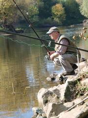 Angler in der Hocke