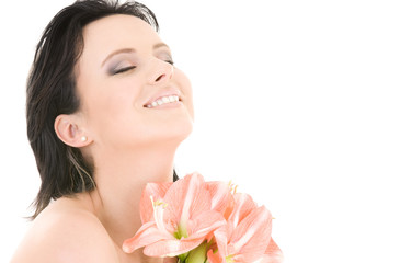 happy woman with pink madonna lily flowers over white