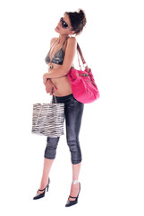 Young brunette girl in bra holding bags and gifts after shopping