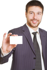 Portrait of  businessman in suit holding his visiting card