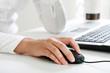 Leinwandbild Motiv Image of female hand touching computer mouse
