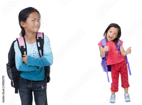 two young asian school girls ready for class.