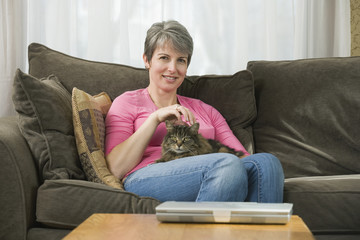 Mature woman holding cat