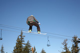 snowboarder high jump on blue sky poster