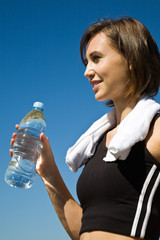 A beautiful sporty caucasian girl carrying a water bottle