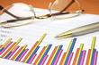 Colorful business chart, eyeglasses and pen