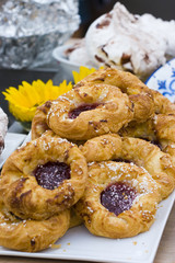 Danishes on a plate with meringue in the background 1