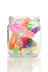 Coloured glues in glass jar