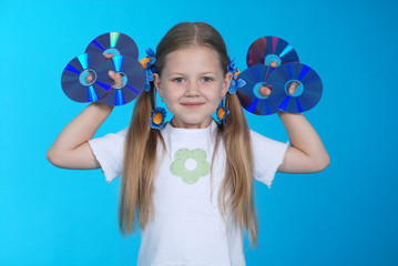 The girl holds CD or DVD