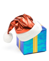 Santa's red hat and gift box on a white background