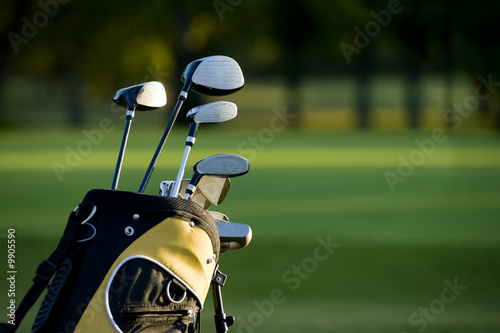 A set up new golf clubs on a beautiful golf course - 9905590