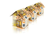 three houses built of euro bills with reflection on white poster