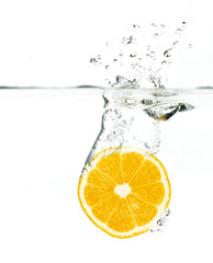 orange jumping into water
