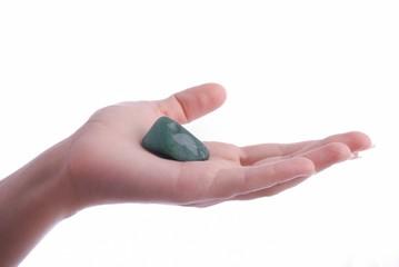Hand holds aventurine - semiprecious gem