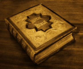 Antique Bible in sepia tones.