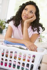 Woman Daydreaming Over Washing Basket