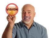 bald man pointing at button that says vision poster