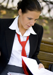 outdoor portrait of smiling businesswoman with documents