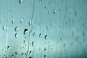 Background of water drops on a window glass in a rainy day