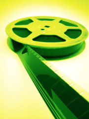 reel of  film of 16 mm on  green background, close up