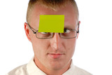 businessman in glasses has sticked on  forehead  paper poster