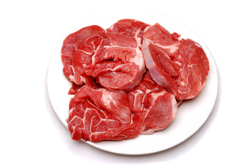 Stewing or braising steak on a white plate