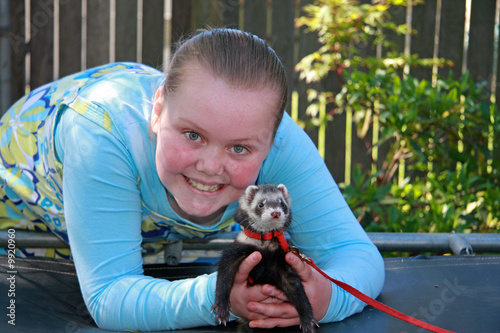 Happy Young with Ferret on Trampoline