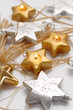 christmas lights - silver and golden stars on white