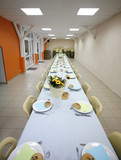 Long party table ready for guests to sit down poster
