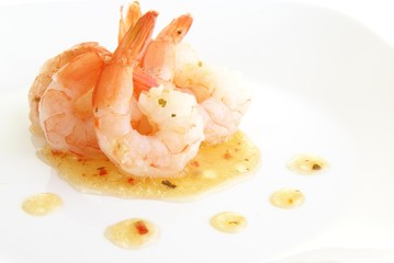 Shrimp with tails in herb oil salad dressing or sauce