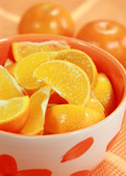 Sliced orange in the bowl - low calorie eating poster