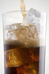 Pouring Cola Into A Glass Of Ice