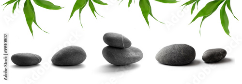 zen-like stones. pebbles and bamboo leaves on white background