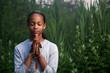 Teenage girl praying outdoors at twilight. Shallow DOF. - 9931965