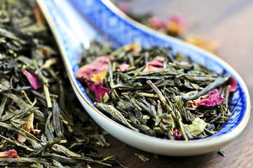 Green tea loose dry leaves in a spoon