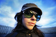 Wide angle portrait of a girl in sunglasses